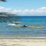 Lobo Batangas Beach Resort Bedroom - boat in water